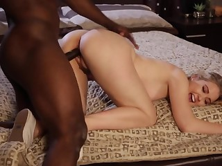 A hot blonde coddle is getting fucked by a large black dude