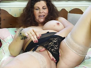 Untrained black-hearted mature granny Gilly strips at home