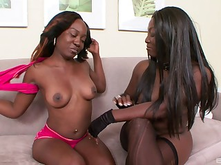 Two ebony models Xena plus Coco Dior have some joke with a strapon