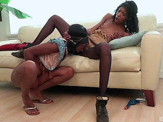 Black girls share their lust on the top of the couch