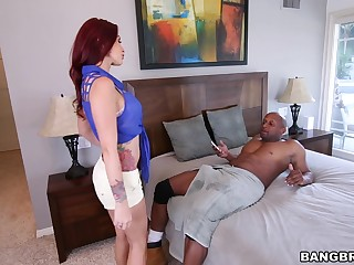 Irresistible redhead Monique Alexander drops on her knees to blow a rod