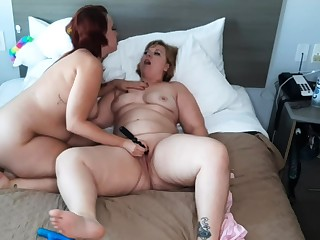 Gilded and brunette lesbians licking pussy