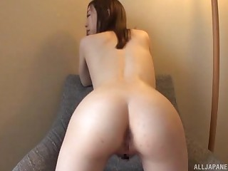 Sweet solo Japanese girl spreads her legs to pleasure her wet cunt