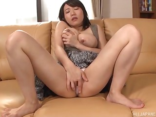 Busty Asian slut recorded herself fingering both her holes